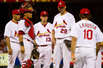 ST. LOUIS - AUGUST 21: Starter Chris Carpenter #29 of the St. Louis Cardinals is removed from the by Cardinals manager Tony LaRussa #10 against the San Francisco Giants at Busch Stadium on August 21, 2010 in St. Louis, Missouri.  (Photo by Dilip Vishwanat