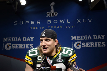 ARLINGTON, TX - FEBRUARY 06:  A.J. Hawk #50 of the Green Bay Packers is interviewed after the Packers defeated the Pittsburgh Steelers 31 to 25 in Super Bowl XLV at Cowboys Stadium on February 6, 2011 in Arlington, Texas.  (Photo by Ronald Martinez/Getty