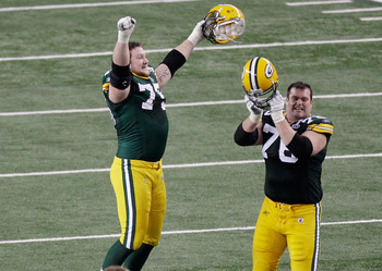 ARLINGTON, TX - FEBRUARY 06:  Bryan Bulaga #75 Chad Clifton #76, and James Jones #89 of the Green Bay Packers celebrate defeating the Pittsburgh Steelers 31 to 25 in Super Bowl XLV at Cowboys Stadium on February 6, 2011 in Arlington, Texas.  (Photo by Rob