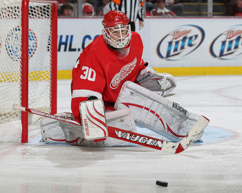DETROIT, MI - JANUARY 2:  Chris Osgood #30 of the Detroit Red Wings turns a shot away in a game against the Philadelphia Flyers on January 2, 2011 at the Joe Louis Arena in Detroit, Michigan. The Flyers defeated the Wings 3-2. (Photo by Claus Anderzen/Get