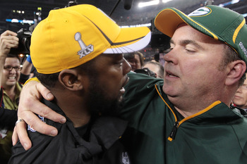 ARLINGTON, TX - FEBRUARY 06:  Head coach Mike McCarthy of the Green Bay Packers is congratulated by head coach Mike Tomlin of the Pittsburgh Steelers after the Packers defeated the Steelers 31 to 25 during Super Bowl XLV at Cowboys Stadium on February 6,