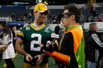ARLINGTON, TX - FEBRUARY 01:  Mason Crosby #2 of the Green Bay Packers is interviewed by a member of the media dresses a superhero during Super Bowl XLV Media Day ahead of Super Bowl XLV at Cowboys Stadium on February 1, 2011 in Arlington, Texas. The Pitt