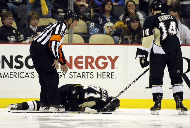 PITTSBURGH, PA - FEBRUARY 04:  Evgeni Malkin #71 of the Pittsburgh Penguins lies injured on the ice during the game against the Buffalo Sabres at Consol Energy Center on February 4, 2011 in Pittsburgh, Pennsylvania.  The Penguins defeated Buffalo 3-2.  (P