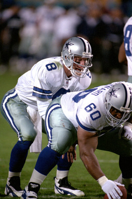 TEMPE, AZ - JANUARY 28:  Quarterback Troy Aikman #8 of the Dallas Cowboys calls a play behind center Derek Kennard #60 during Super Bowl XXX against the Pittsburgh Steelers at Sun Devil Stadium on January 28, 1996 in Tempe, Arizona.  The Cowboys won 27-17