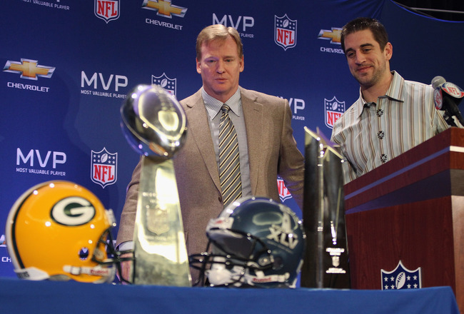DALLAS, TX - FEBRUARY 07:  NFL Commissioner Roger Goodell (L) and Green Bay Packers quarterback Aaron Rodgers (R) look on after speaking to the media during a press conference at Super Bowl XLV Media Center on February 7, 2011 in Dallas, Texas.  (Photo by