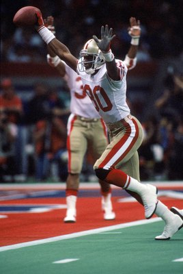 NEW ORLEANS - JANUARY 28:  Wide receiver Jerry Rice #80 of the San Francisco 49ers celebrates on his way to the end zone for a touchdown in Super Bowl XXIV against the Denver Broncos at Louisiana Superdome on January 28, 1990 in New Orleans, Louisiana.  T
