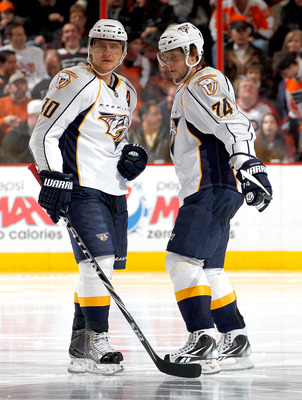 PHILADELPHIA, PA - FEBRUARY 03:  Martin Erat #10 and Sergei Kostitsyn #74 of the Nashville Predators talk during a timeout in an NHL hockey game against the Philadelphia Flyers at the Wells Fargo Center on February 3, 2011 in Philadelphia, Pennsylvania.