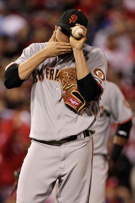 PHILADELPHIA - OCTOBER 23:  Jonathan Sanchez #57 of the San Francisco Giants reacts to giving up a first inning RBI double to Chase Utley of the Philadelphia Phillies in Game Six of the NLCS during the 2010 MLB Playoffs at Citizens Bank Park on October 23