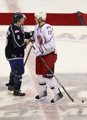 RALEIGH, NC - JANUARY 30:  Team Lidstrom captain Nicklas Lidstrom #5 of the Detroit Red Wings shakes hands with Team Staal captain Eric Staal #12 of the Carolina Hurricanes after Team Lidstrom defeated Team Staal 11 to 10 in the 58th NHL All-Star Game at