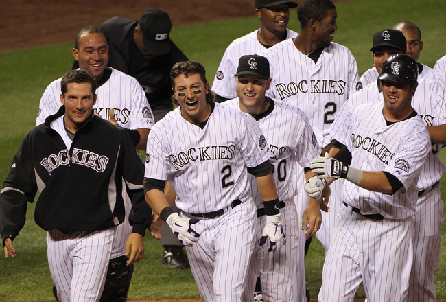 DENVER - SEPTEMBER 25:  Troy Tulowitzki #2 of the Colorado Rockies celebrates with Huston Street (L) and their teammates after he hit the game RBI double to score Carlos Gonzalez #5 against the San Francisco Giants in the 10th inning at Coors Field on Sep