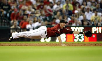 HOUSTON - AUGUST 15:  Third baseman Chris Johnson #23 of the Houston Astrosn dives but comes up short on a hard hit ball by Chris Snyder #19 of the Pittsburgh Pirates in the third inning at Minute Maid Park on August 15, 2010 in Houston, Texas.  (Photo by