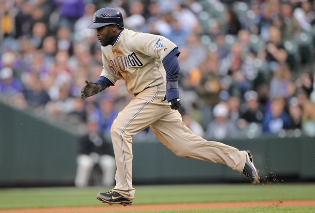 DENVER - APRIL 10:  Centerfielder Tony Gwynn Jr. #18 of the San Diego Padres steals secondbase against starting pitcher Jason Hammel of the Colorado Rockies during MLB action at Coors Field on April 10, 2010 in Denver, Colorado. The Padres defeated the Ro