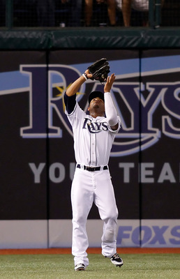 ST. PETERSBURG - SEPTEMBER 13:  Outfielder Carl Crawford #13 of the Tampa Bay Rays catches a fly ball against the New York Yankees during the game at Tropicana Field on September 13, 2010 in St. Petersburg, Florida.  (Photo by J. Meric/Getty Images)