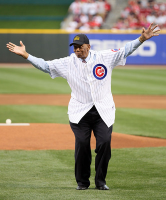 CINCINNATI - MAY 15:  Ernie Banks waves to the crowd after throwing out the first pitch before the Gillette Civil Rights Game between the Cincinnati Reds and the St. Louis Cardinals at Great American Ball Park on May 15, 2010 in Cincinnati, Ohio.  (Photo