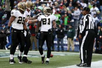 SEATTLE, WA - JANUARY 08:  Julius Jones #21 of the New Orleans Saints and his teammates react against the Seattle Seahawks during the 2011 NFC wild-card playoff game at Qwest Field on January 8, 2011 in Seattle, Washington.  (Photo by Jonathan Ferrey/Gett
