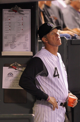 DENVER - SEPTEMBER 27:  Manager Jim Tracy #4 of the Colorado Rockies looks on from the dugout as they face the Los Angeles Dodgers at Coors Field on September 25, 2010 in Denver, Colorado. Jiimenez failed to earn his 20th win of the season.  (Photo by Dou