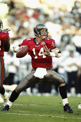 SAN DIEGO - JANUARY 26:  Quarterback Brad Johnson #14 of the Tampa Bay Buccaneers looks for a receiver during Super Bowl XXXVII against the Oakland Raiders at Qualcomm Stadium on January 26, 2003 in San Diego, California.  The Buccaneers defeated the Raid