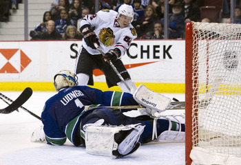 VANCOUVER, CANADA - JANUARY 4: Goalie Roberto Luongo #1 of the Vancouver Canucks sprawls and watches Tomas Kopecky #82 of the Chicago Blackhawks hit the post with his shot during the third period in NHL action on February 04, 2011 at Rogers Arena in Vanco