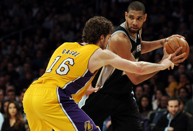 LOS ANGELES, CA - FEBRUARY 03:  Tim Duncan #21 of the San Antonio Spurs faces off against Pau Gasol #16 of the Los Angeles Lakers during a 89-88 Spur victory at Staples Center on February 3, 2011 in Los Angeles, California.  NOTE TO USER: User expressly a