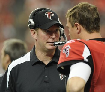 ATLANTA - NOVEMBER 9: Quarterback Matt Ryan #2 of the Atlanta Falcons talks with quarterbacks coach Bill Musgrave during play against the New Orleans Saints at the Georgia Dome on November 9, 2008 in Atlanta, Georgia.  (Photo by Al Messerschmidt/Getty Ima