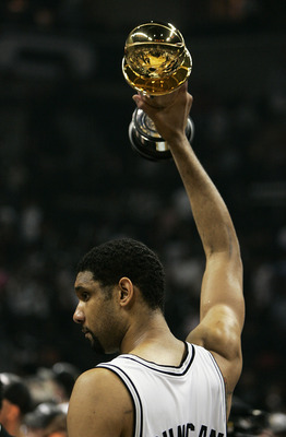 SAN ANTONIO - JUNE 23:  Tim Duncan #21 of the San Antonio Spurs celebrates with the Finals MVP Trophy after defeating the Detroit Pistons in Game seven of the 2005 NBA Finals at SBC Center on June 23, 2005 in San Antonio, Texas. The Spurs defeated the Pis