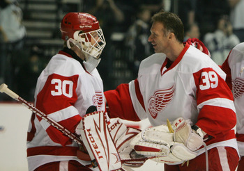 NASHVILLE, TN - APRIL 20: Chris Osgood #30 of the Detroit Red Wings is congratulated by Dominik Hasek #39 on Osgood's shut out victory over the Nashville Predators on April 20, 2008 during game six of the Western Conference Quarterfinals of the 2008 NHL S