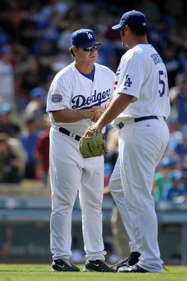 LOS ANGELES, CA - APRIL 18:  Pitching coach Rick Honeycutt #40 of the Los Angeles Dodgers congratulates Jonathan Broxton #51 against the San Francisco Giants at Dodger Stadium on April 18, 2010 in Los Angeles, California. The Dodgers defeated the Giants 2