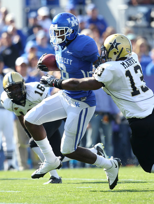 LEXINGTON, KY - NOVEMBER 13:  Chris Matthews #8 of the Kentucky Wildcats runs with the ball while defended by Chris Marve #13 of the Vanderbilt Commodores at Commonwealth Stadium on November 13, 2010 in Lexington, Kentucky.  (Photo by Andy Lyons/Getty Ima
