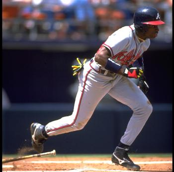 22 APR 1992:  ATLANTA BRAVES OUTFIELDER DEION SANDERS RUNS TO FIRST BASE AFTER MAKING CONTACT WITH A PITCH DURING THE BRAVES VERSUS SAN DIEGO PADRES GAME AT JACK MURPHY STADIUM IN SAN DIEGO, CALIFORNIA.  MANDATORY CREDIT:  STEPHEN DUNN/ALLSPORT