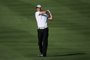 DOHA, QATAR - FEBRUARY 04:  Martin Kaymer of Germany hits his second shot on the 14th hole during the second round of the Commercialbank Qatar Masters held at Doha Golf Club on February 4, 2011 in Doha, Qatar.  (Photo by Andrew Redington/Getty Images)