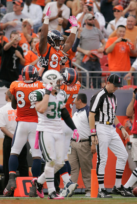 DENVER - OCTOBER 17:  Wide receiver Demaryius Thomas #88 of the Denver Broncos celebrates his touchdown with teammates Daniel Graham #89 and Chris Kuper #73 as safety Jim Leonhard #36 the New York Jets walks off at INVESCO Field at Mile High on October 17