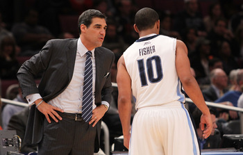 NEW YORK - NOVEMBER 26: Head coach of the Villanova Wildcats, Jay Wright talks with Corey Fisher #10 against the Tennessee Volunteers during the Championship game at Madison Square Garden on November 26, 2010 in New York City.  (Photo by Nick Laham/Getty