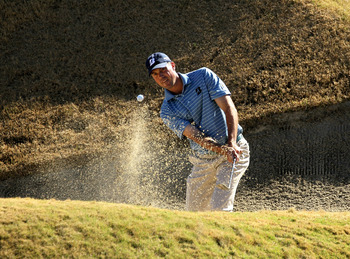 LA QUINTA, CA - JANUARY 21:  Matt Kuchar hits out of a bunker on the 17th hole during round three of the Bob Hope Classic at the Nicklaus Private Course at PGA West on January 21, 2011 in La Quinta, California. (Photo by Stephen Dunn/Getty Images)