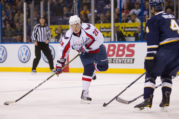 ST. LOUIS, MO - DECEMBER 01: Alexander Semin #28 of the Washington Capitals looks to pass the puck against the St. Louis Blues at the Scottrade Center on December 1, 2010 in St. Louis, Missouri.  (Photo by Dilip Vishwanat/Getty Images)
