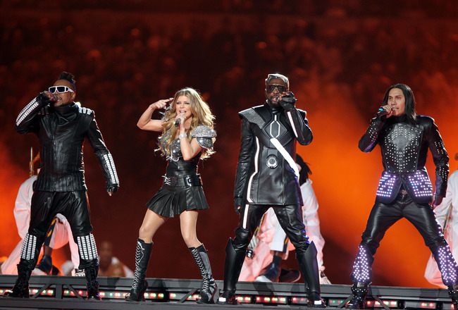 ARLINGTON, TX - FEBRUARY 06:  apl.de.ap, Fergie, will.i.am and Taboo of The Black Eyed Peas perform during the Bridgestone Super Bowl XLV Halftime Show at Dallas Cowboys Stadium on February 6, 2011 in Arlington, Texas.  (Photo by Christopher Polk/Getty Im