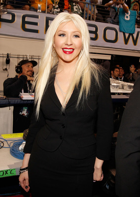 ARLINGTON, TX - FEBRUARY 06:  Singer Christina Aguilera attends the Bridgestone Super Bowl XLV Pregame Show at Dallas Cowboys Stadium on February 6, 2011 in Arlington, Texas.  (Photo by Christopher Polk/Getty Images)