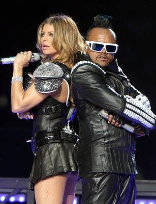 ARLINGTON, TX - FEBRUARY 06:  Fergie and apl.de.ap of The Black Eyed Peas perform during the Bridgestone Super Bowl XLV Halftime Show at Dallas Cowboys Stadium on February 6, 2011 in Arlington, Texas.  (Photo by Christopher Polk/Getty Images)