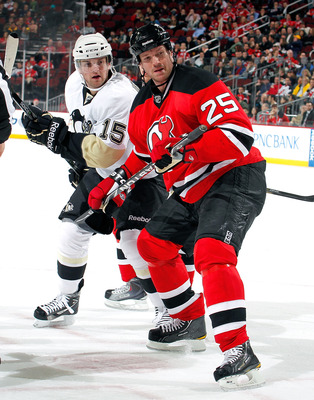 NEWARK, NJ - JANUARY 20:  Dustin Jeffrey #15 of the Pittsburgh Penguins and Jason Arnott #25 of the New Jersey Devils turn toward puck in an NHL hockey game at the Prudential Center on January 20, 2011 in Newark, New Jersey.  (Photo by Paul Bereswill/Gett