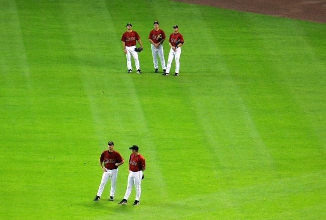 HOUSTON - APRIL 2:  Members of the Houston Astros stand in the outfield during batting practice before the game against the Pittsburgh Pirates on April 2, 2007 at Minute Maid Park in Houston, Texas. (Photo by Stephen Dunn/Getty Images)
