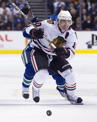 VANCOUVER, CANADA - JANUARY 4: Patrick Sharp #10 of the Chicago Blackhawks chases the loose puck with Cody Hodgson #39 of the Vancouver Canucks in pursuit during the third period in NHL action on February 04, 2011 at Rogers Arena in Vancouver, British Col