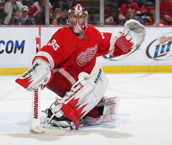 DETROIT, MI - FEBRUARY 4:  Jimmy Howard #35 of the Detroit Red Wings turns a shot away in a game against the Columbus Blue Jackets on February 4, 2011 at the Joe Louis Arena in Detroit, Michigan. The Blue Jackets defeated the Wings 3-0. (Photo by Claus An