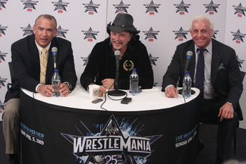 HOUSTON, TX - APRIL 5:  Former professional wrestler Ricky 'The Dragon' Steamboat and 'Nature Boy' Ric Flair looks on as actor Mickey Rourke discusses his wishes to not get involved in a match with WWE Superstar Chris Jericho during a press conference bef