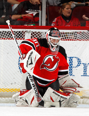 NEWARK, NJ - FEBRUARY 01:  Goalie Martin Brodeur #30 of the New Jersey Devils makes a save during an NHL hockey game against the Ottawa Senators at the Prudential Center on February 1, 2011 in Newark, New Jersey.  (Photo by Paul Bereswill/Getty Images)