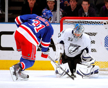 NEW YORK, NY - DECEMBER 23:  Alex Frolov #31 of the New York Rangers is stopped by Goalie Dan Ellis #33 of the Tampa Bay Lightning during the shootout of an NHL hockey game at Madison Square Garden on December 23, 2010 in New York City.  (Photo by Paul Be
