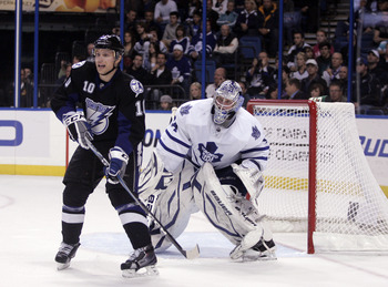 TAMPA, FL - JANUARY 25: James Reimer #34 of the Toronto Maple Leafs protects the net against Sean Bergenheim #10 of the Tampa Bay Lightning at St. Pete Times Forum on January 25, 2011 in Tampa, Florida. The Lightning defeated the Leafs 2-0. (Photo by Just