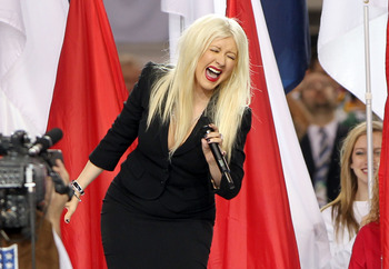 ARLINGTON, TX - FEBRUARY 06:  Singer Christina Aguilera performs during the Bridgestone Super Bowl XLV Pregame Show at Dallas Cowboys Stadium on February 6, 2011 in Arlington, Texas.  (Photo by Christopher Polk/Getty Images)