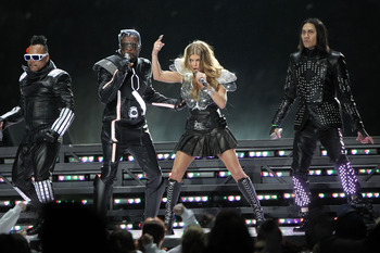 ARLINGTON, TX - FEBRUARY 06:  apl.de.ap, will.i.am, Fergie and Taboo of The Black Eyed Peas perform during the Bridgestone Super Bowl XLV Halftime Show at Dallas Cowboys Stadium on February 6, 2011 in Arlington, Texas.  (Photo by Christopher Polk/Getty Im