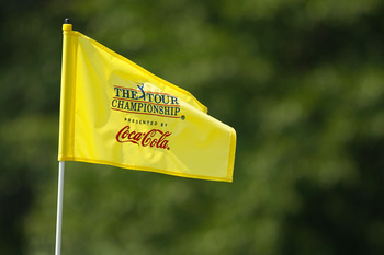 ATLANTA - SEPTEMBER 23:  A flag blows in the breeze on the practice range during the first round of THE TOUR Championship presented by Coca-Cola at East Lake Golf Club on September 23, 2010 in Atlanta, Georgia.  (Photo by Scott Halleran/Getty Images)