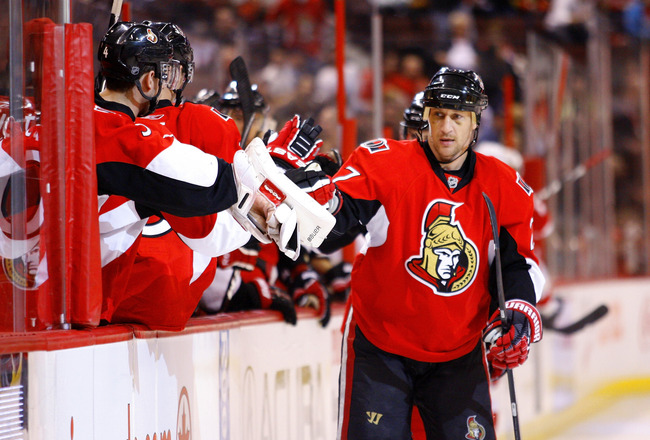 OTTAWA, ON - FEBRUARY 02:  Alex Kovalev #27 of the Ottawa Senators celebrates his goal against the Detroit Red Wings with his teammates on the bench in a game at Scotiabank Place on February 2, 2011 in Ottawa, Canada.  (Photo by Phillip MacCallum/Getty Im