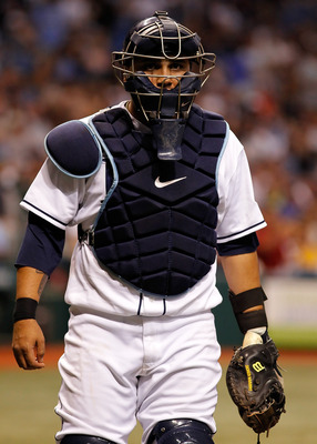 ST. PETERSBURG - APRIL 23:  Catcher Dioner Navarro #30 of the Tampa Bay Rays walks back to the dugout during the game against the Toronto Blue Jays at Tropicana Field on April 23, 2010 in St. Petersburg, Florida.  (Photo by J. Meric/Getty Images)